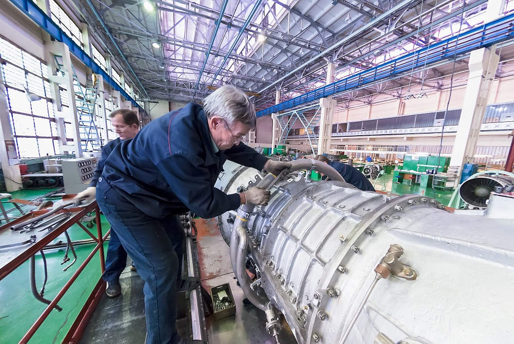 Mechanics work over assembly of aviation engine